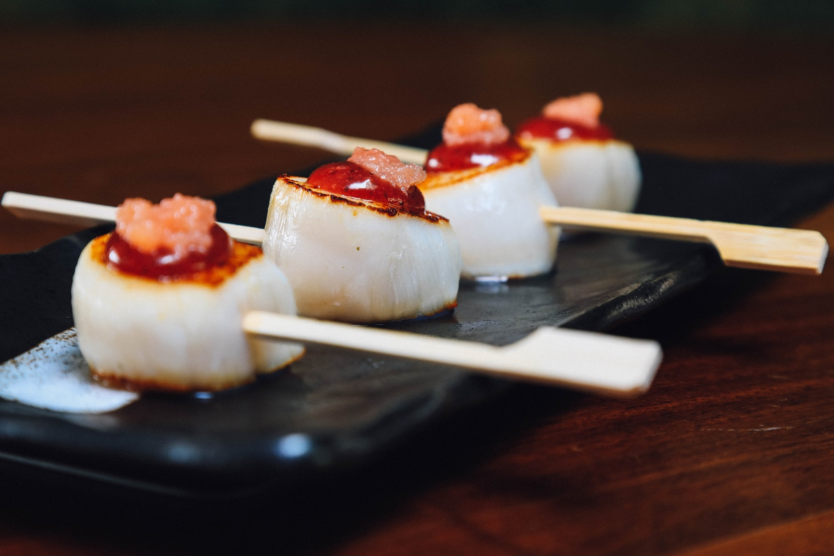 LAVA ROCK GRILLED SCALLOPS WITH UMEBOSHI SAUCE AND MENTAIKO